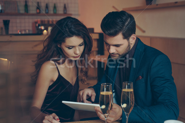 Stock photo: couple with table in restaurant