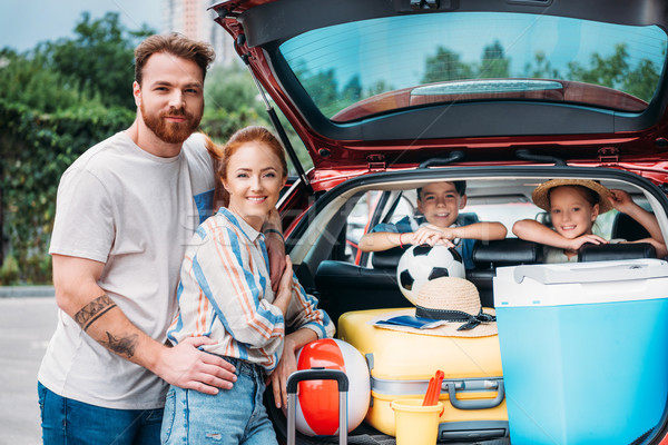 family packing luggage in car trunk Stock photo © LightFieldStudios