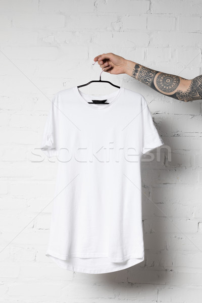 Blanche tshirt coup homme cintre Photo stock © LightFieldStudios