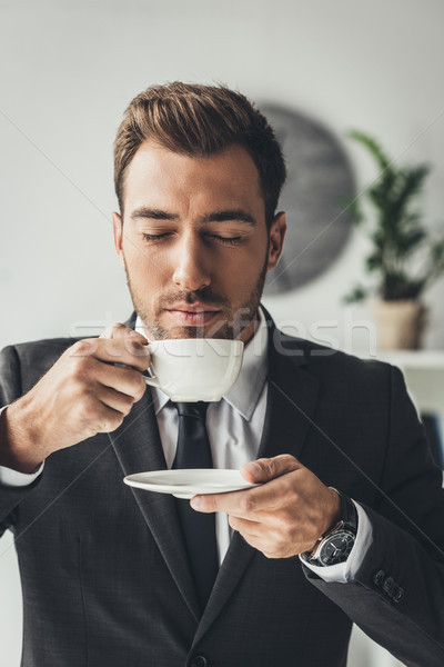 businessman enjoying aromatic coffee Stock photo © LightFieldStudios