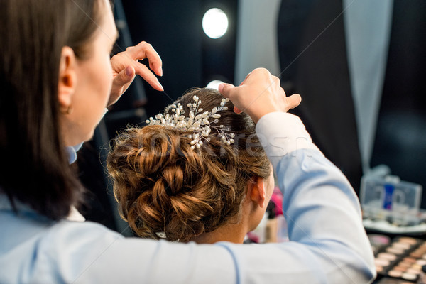 hairstylist decorating clients hairstyle Stock photo © LightFieldStudios