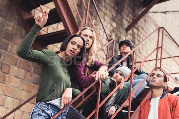 stylish young people on stairs Stock photo © LightFieldStudios