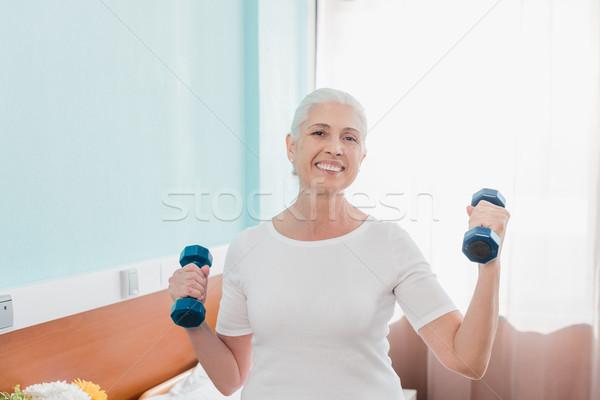 senior woman with dumbbells in hospital Stock photo © LightFieldStudios