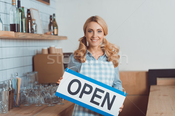 waitress holding sign open Stock photo © LightFieldStudios