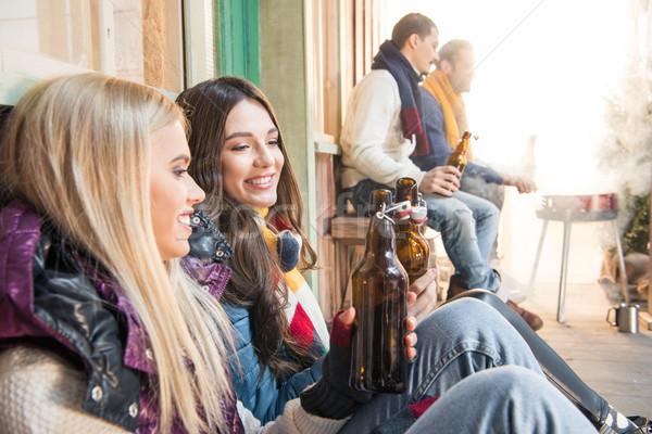 Oldalnézet derűs barátok iszik sör barbecue Stock fotó © LightFieldStudios