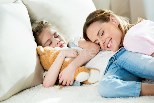 Stock photo: Happy mother and cute little girl with teddy bear sleeping