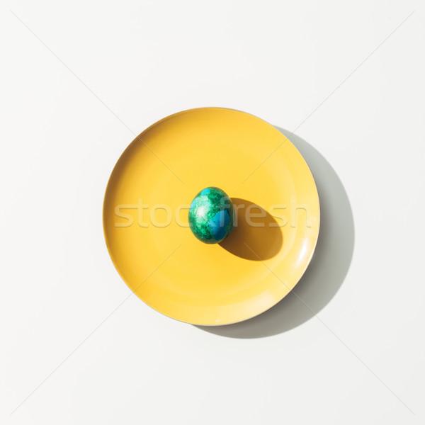 Haut vue minable vert œuf de Pâques jaune Photo stock © LightFieldStudios