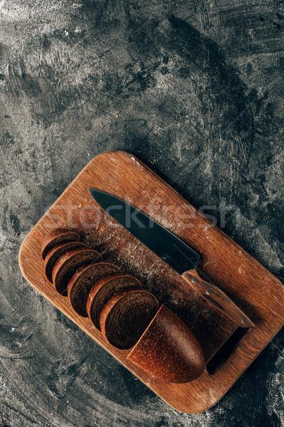 Superior vista piezas pan tabla de cortar cuchillo Foto stock © LightFieldStudios