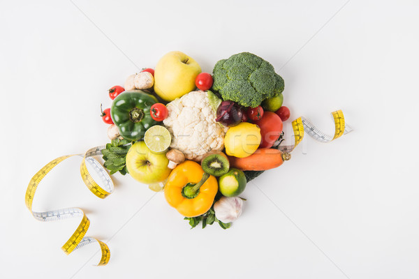 various vegetables laying on white background  with measuring tape Stock photo © LightFieldStudios