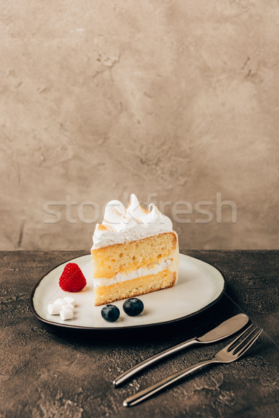 close-up view of sweet delicious cake with berries and whipped cream on plate Stock photo © LightFieldStudios