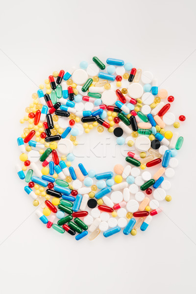 Top view of letter O made from medical pills and capsules, medicine and healthcare concept Stock photo © LightFieldStudios