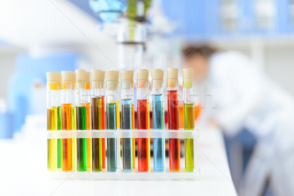 Close-up view of test tubes with reagents on white table in laboratory Stock photo © LightFieldStudios