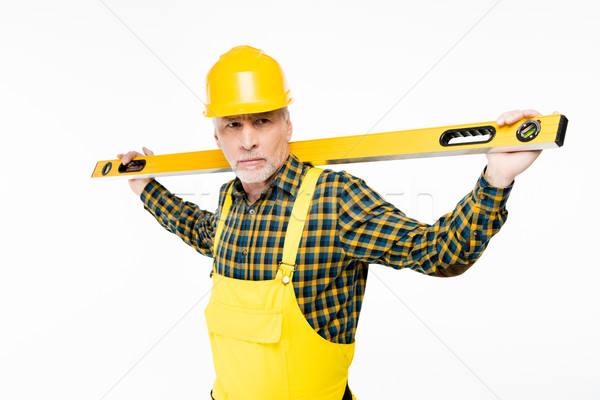 Workman with level tool Stock photo © LightFieldStudios