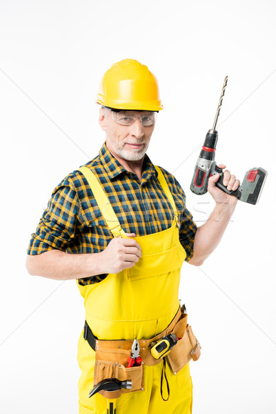 Workman holding electric drill Stock photo © LightFieldStudios