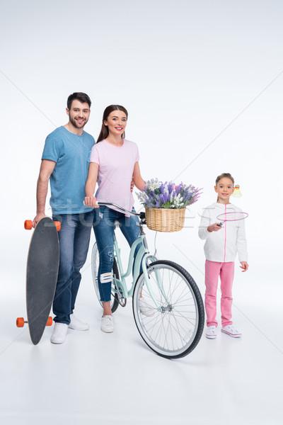 Mosolyog család gördeszka bicikli fehér nő Stock fotó © LightFieldStudios