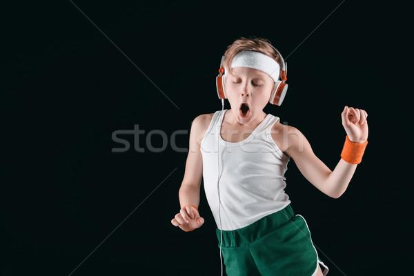 Retrato menino escuta música fones de ouvido isolado Foto stock © LightFieldStudios
