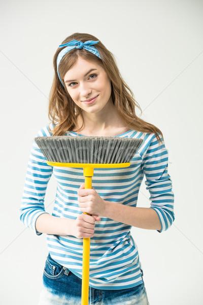 Jonge vrouw bezem aantrekkelijk glimlachend camera Stockfoto © LightFieldStudios