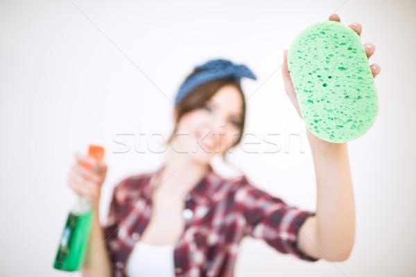 Kadın sprey şişe sünger genç Stok fotoğraf © LightFieldStudios
