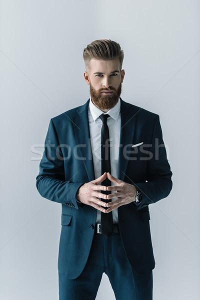 あごひげを生やした ビジネスマン スタイリッシュ スーツ 見える カメラ ストックフォト © LightFieldStudios