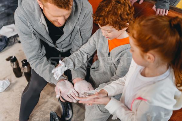 Dad showing how to apply talcum Stock photo © LightFieldStudios
