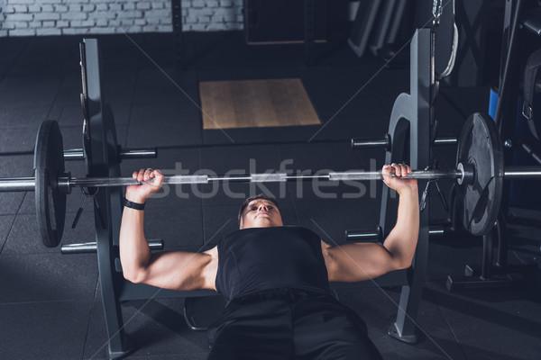 man lifting barbell Stock photo © LightFieldStudios