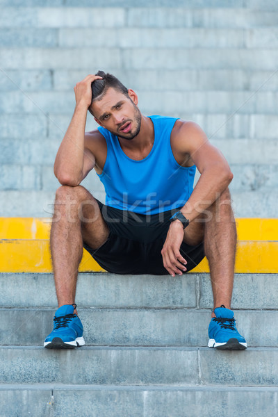 tired sportsman on stairs  Stock photo © LightFieldStudios