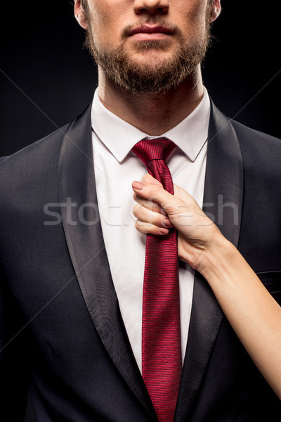 Woman holding businessman by tie Stock photo © LightFieldStudios