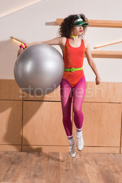 stylish woman with fitness ball Stock photo © LightFieldStudios