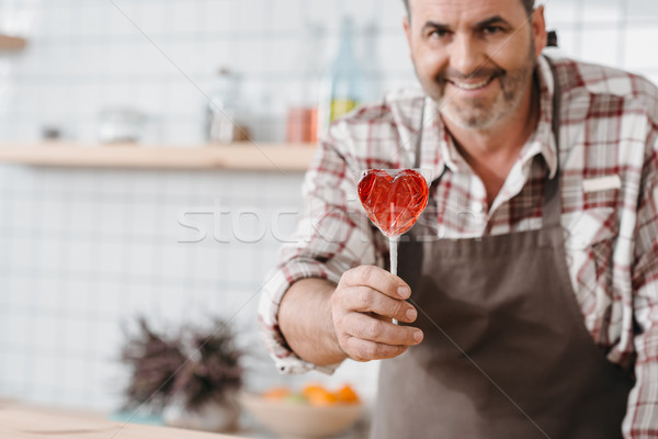 bartender with lollypop in shape of heart Stock photo © LightFieldStudios