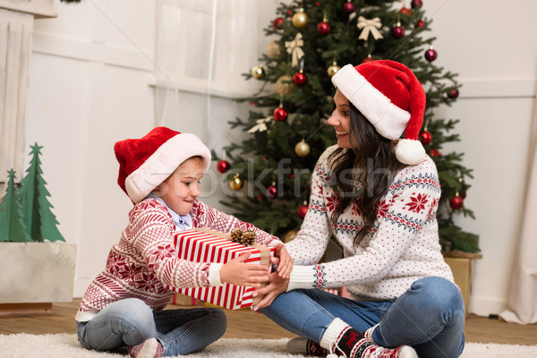Stock photo: mother and daughter with christmas gift
