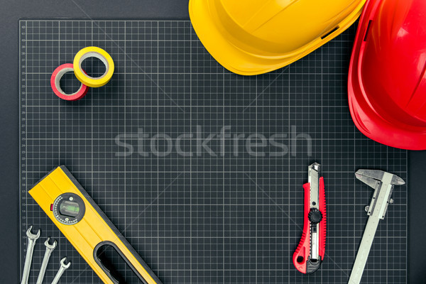 tools and hardhats on graph paper Stock photo © LightFieldStudios