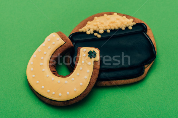 high angle view of icing cookies in shape of horseshoe and pot with coins on green, st patricks day  Stock photo © LightFieldStudios