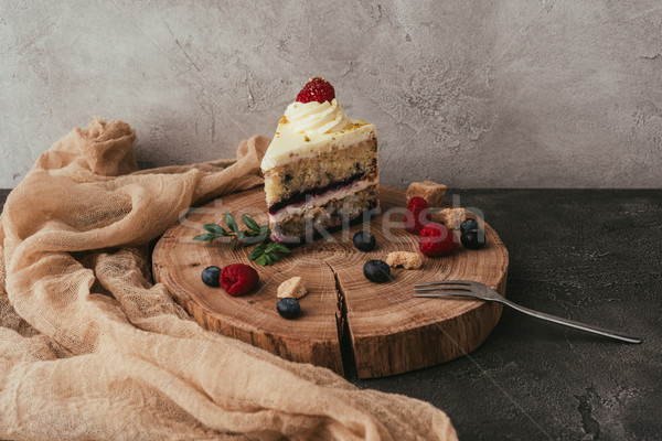 close-up view of delicious fruity cake with whipped cream on wooden board  Stock photo © LightFieldStudios