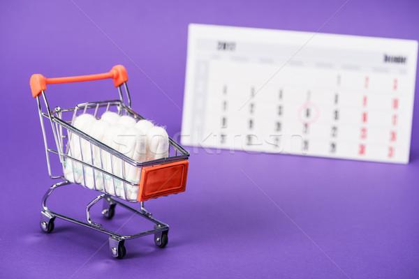 Kicsi bevásárlókocsi naptár lila gyógyszer női Stock fotó © LightFieldStudios