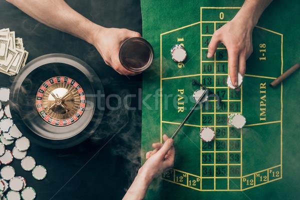 Füst emberek játszik rulett kaszinó asztal Stock fotó © LightFieldStudios