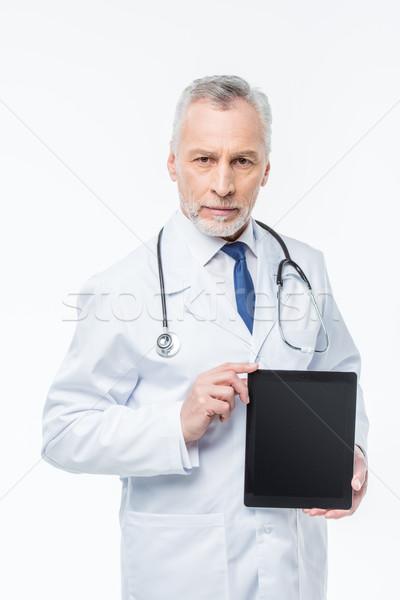 Stock photo: Doctor holding digital tablet