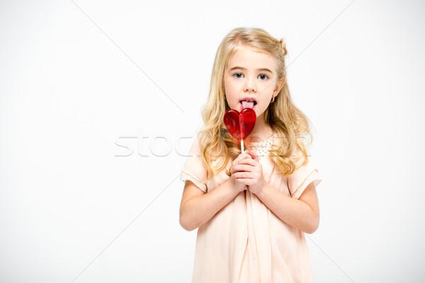 Meisje hart lolly cute meisje Stockfoto © LightFieldStudios