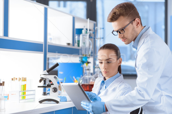 portrait of concentrated scientists using digital tablet for analysis in laboratory  Stock photo © LightFieldStudios