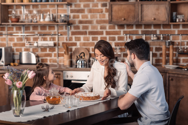 'surprised mother with cake on mother's day holiday with family near by Stock photo © LightFieldStudios