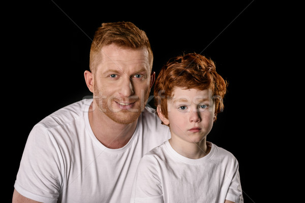 Happy father with son wearing white t-shirts isolated on black Stock photo © LightFieldStudios