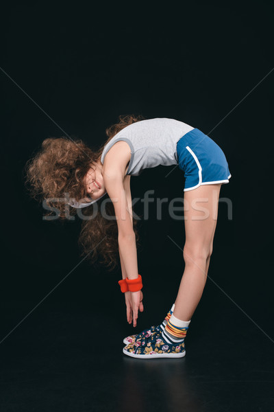 girl in sportswear exercising isolated on black. acting kids, 11 year old kids concept Stock photo © LightFieldStudios