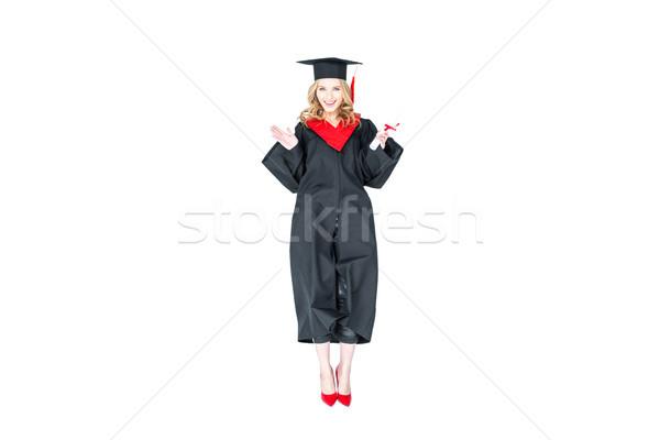 Atraente estudante graduação boné diploma saltando Foto stock © LightFieldStudios