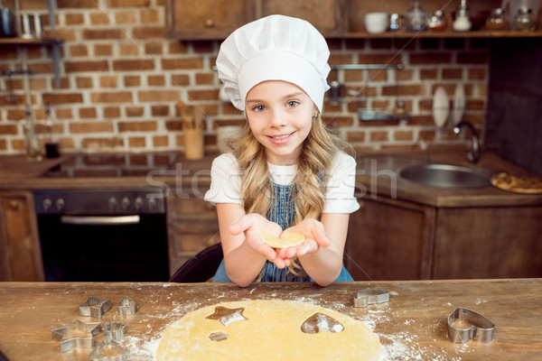 girl holding raw heart shaped dough for cookie  Stock photo © LightFieldStudios