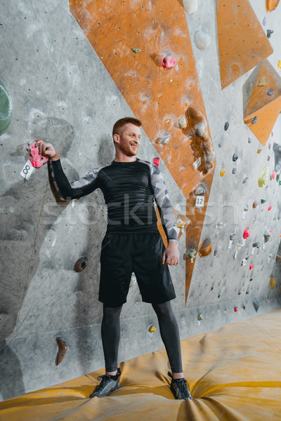 young man near climbing wall Stock photo © LightFieldStudios