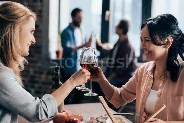 female friends drinking wine Stock photo © LightFieldStudios