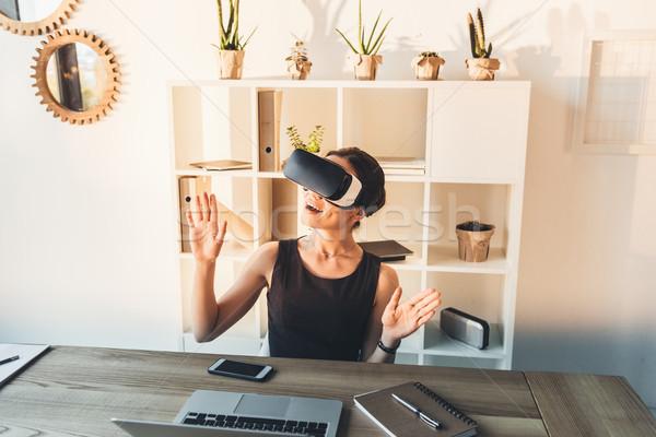 businesswoman using VR glasses Stock photo © LightFieldStudios