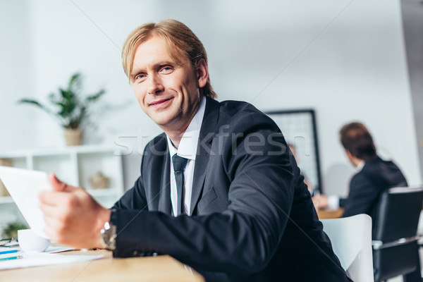 smiling middle aged businessman Stock photo © LightFieldStudios