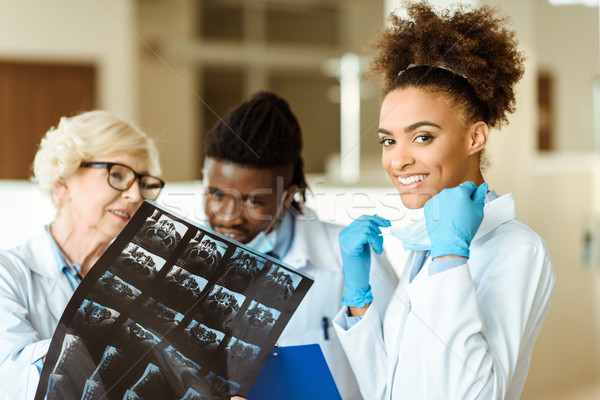 Young african american doctor with colleagues Stock photo © LightFieldStudios