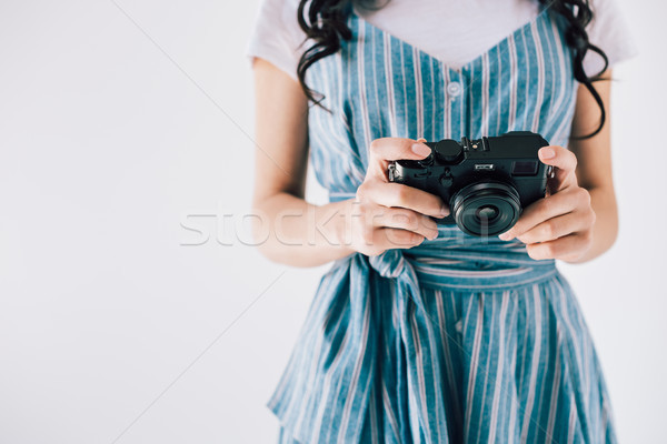 woman holding photo camera Stock photo © LightFieldStudios