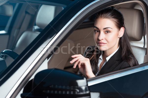 Smiling woman driving car Stock photo © LightFieldStudios